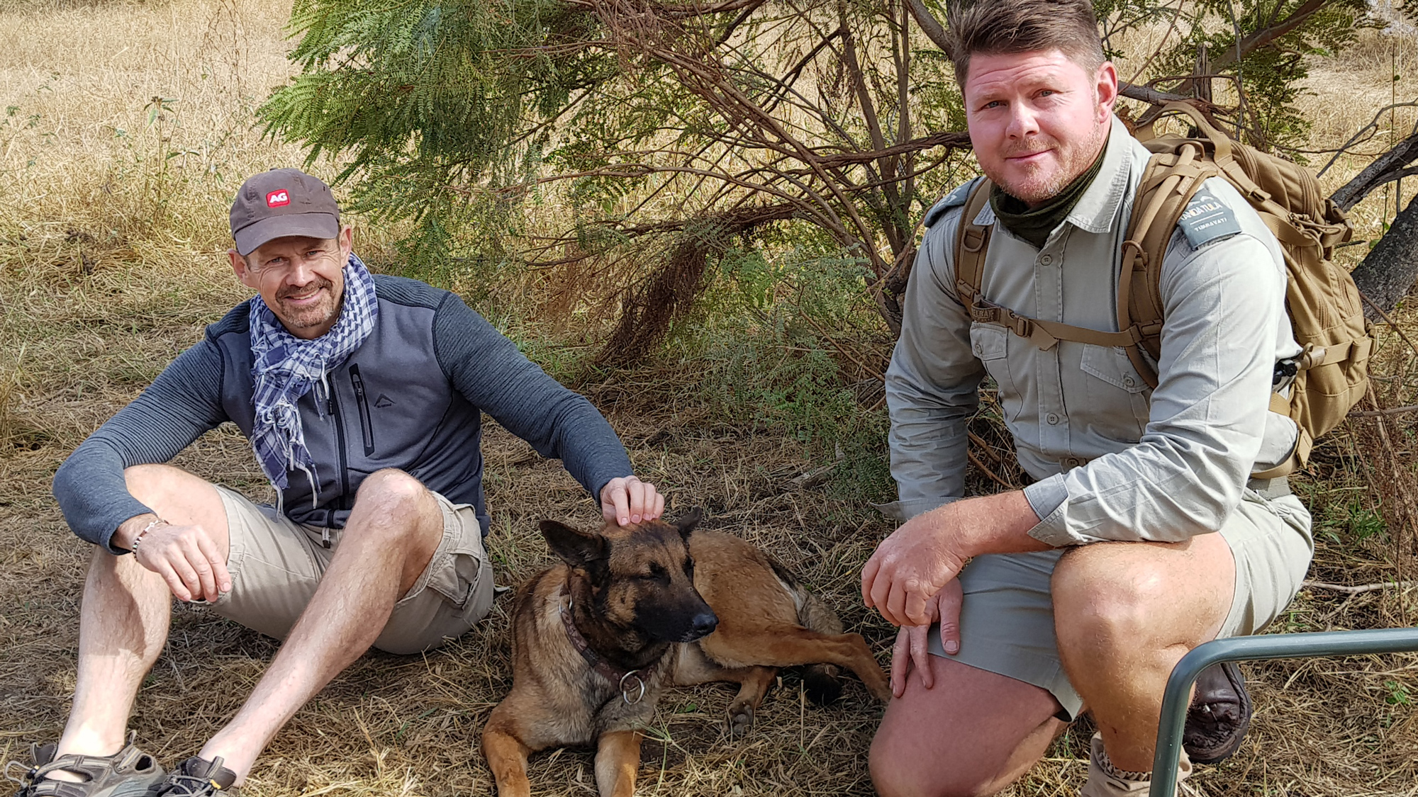 Head guide and guest with K9 anti-poaching dog