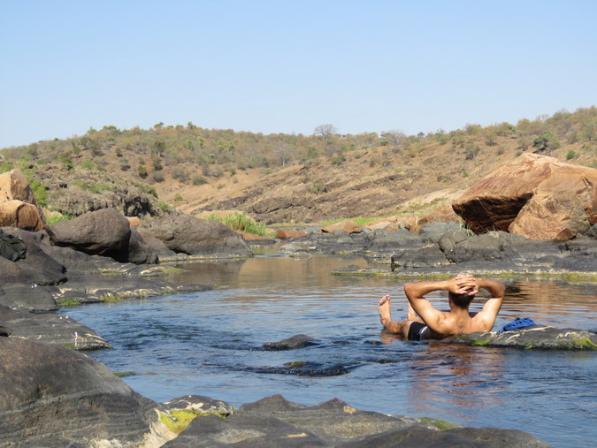 Ranger relaxing in the river in Kruger National Park in South Africa