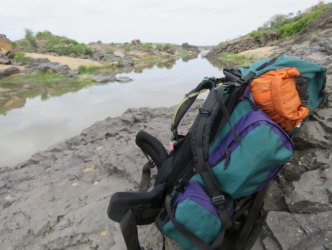 Backpack alongside riverbank in Kruger National Park in South Africa