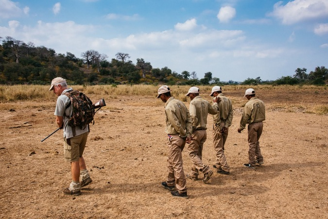 Guide and four trackers searching for tracks in the Makuleke Concession