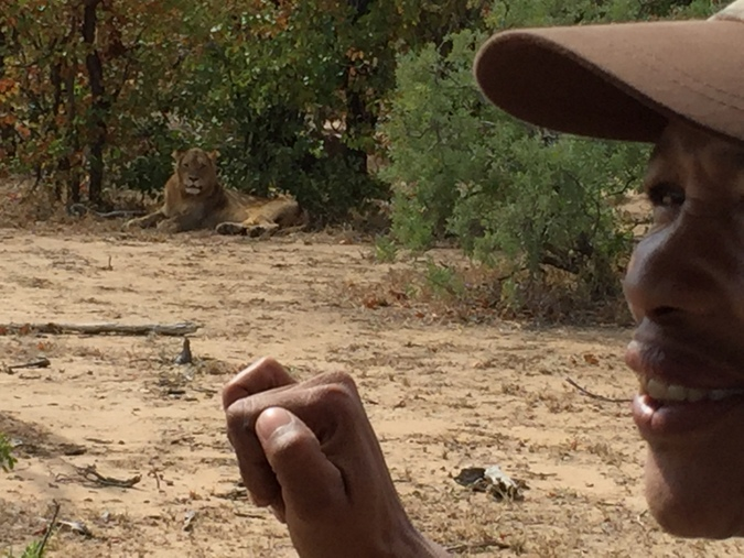 Master Tracker showing the sign for a lion in Kruger National Park