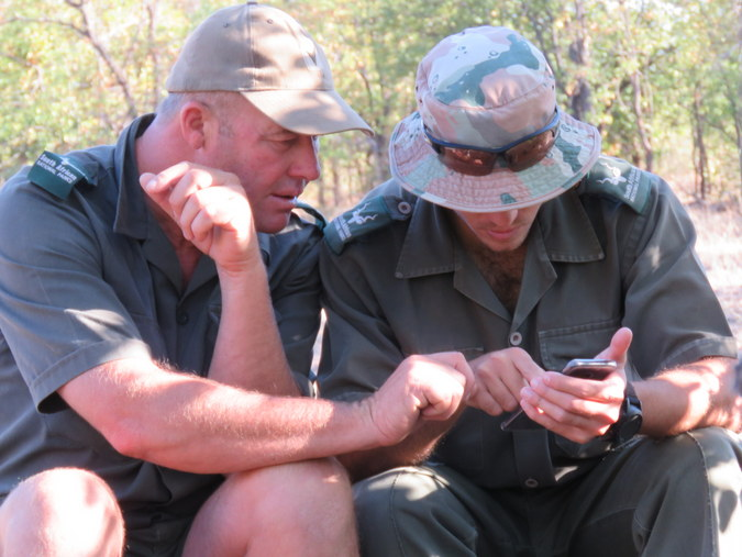Two rangers looking at a GPS in Kruger National Park in South Africa