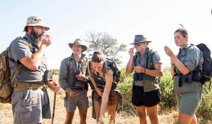 Safari guide training students in the bush in South Africa