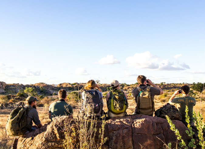 EcoTraining students surveying the landscape in the African bush