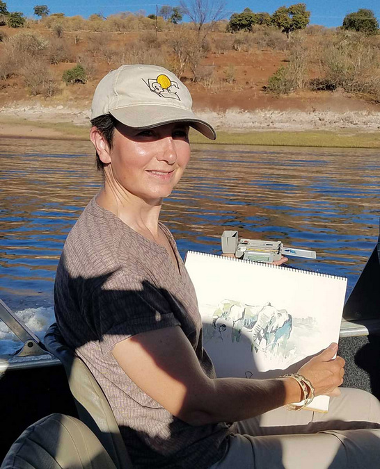 Alison Nicholls painting while on a boat in Botswana