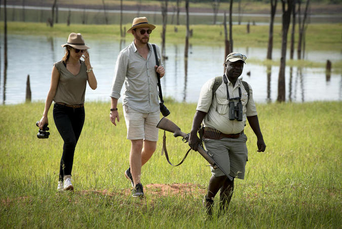 Guests head out on a walking safari at Lake Kariba