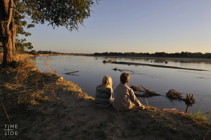 Two guests sitting by the river in Zambia