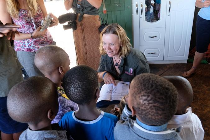 Carla Geyser talking with local school children