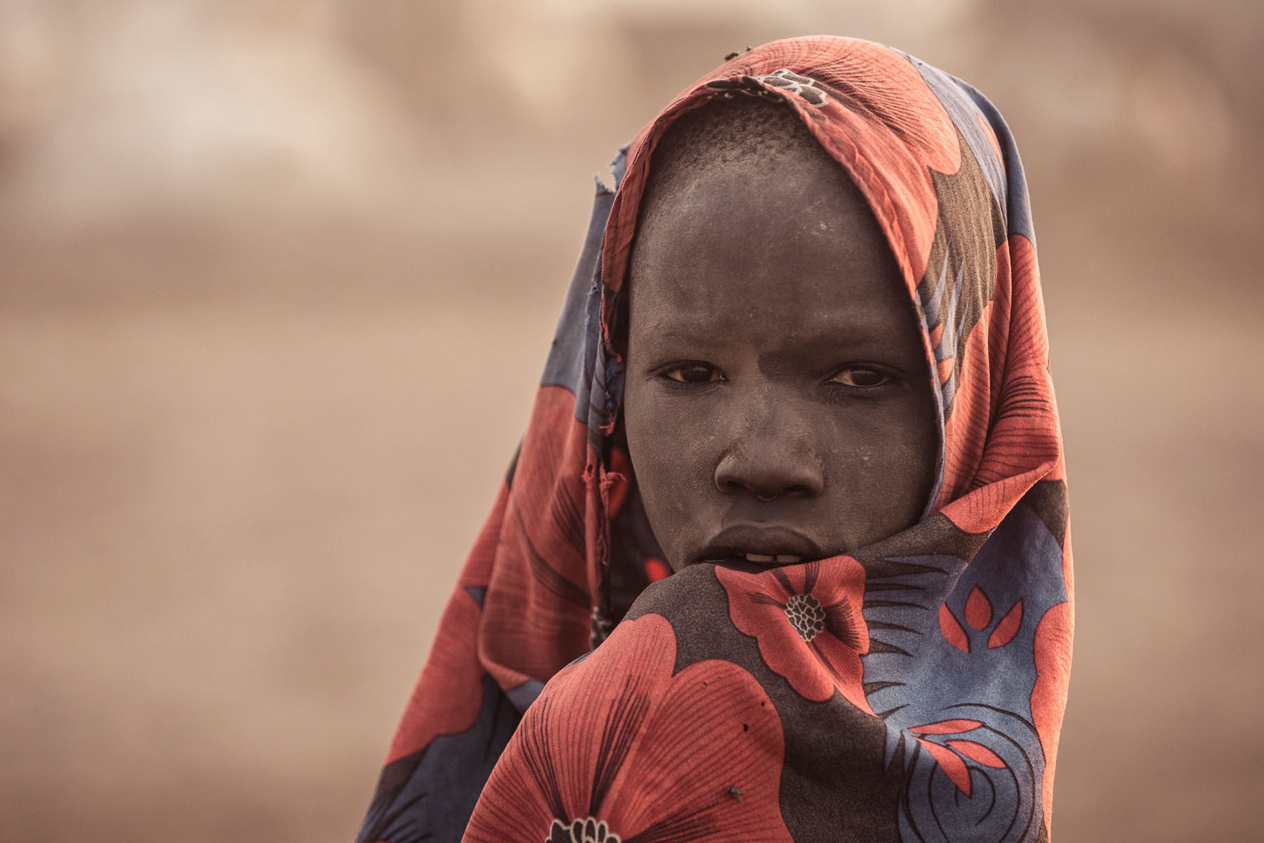 A Mundari boy atsunrise© Joe Buergi