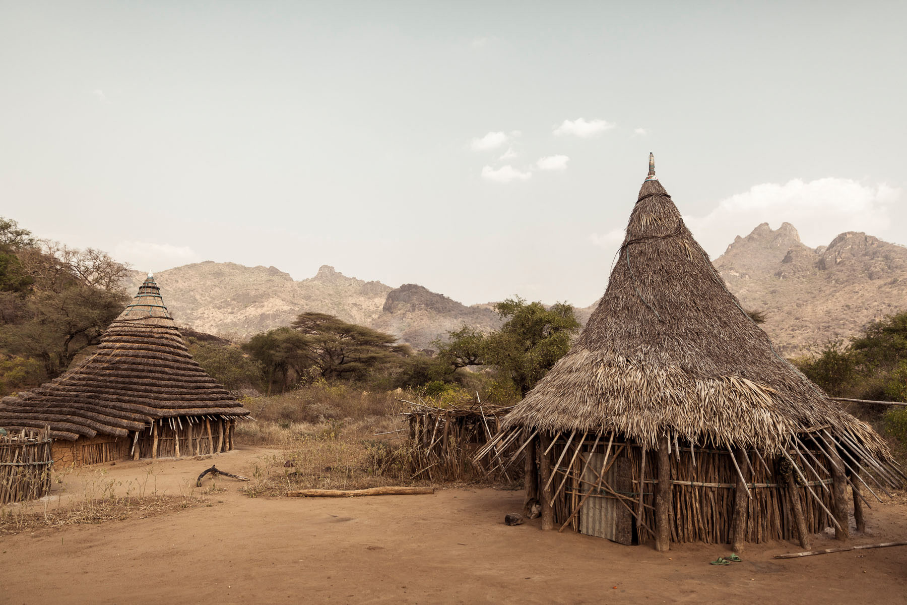 Boya Hills is a rugged and hilly terrain with rich savanna, high grasslands and scrub bushes. The Boya live in small settlements, with the main town being Kimatong © Joe Buergi
