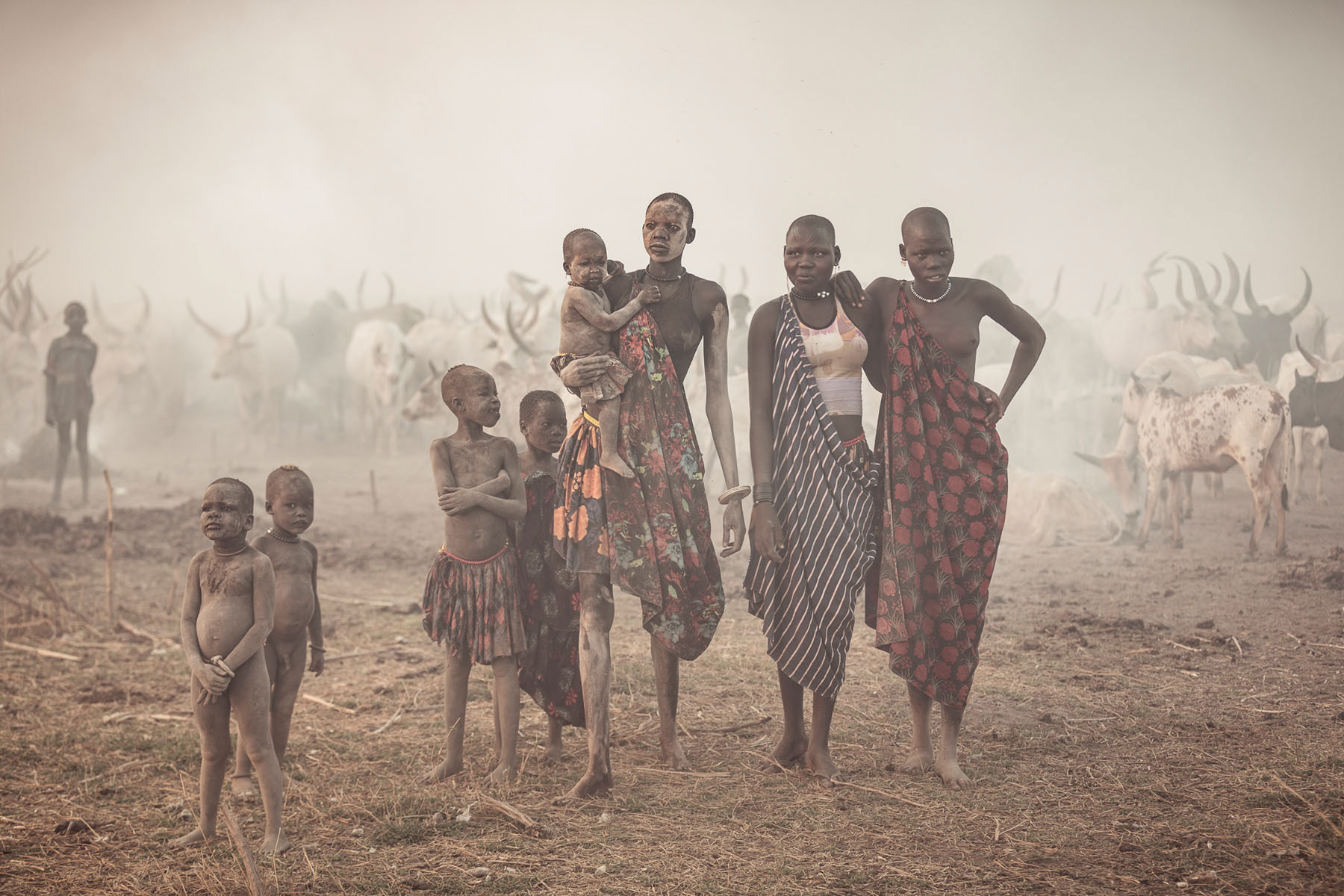 Mundari woman and children at sunrise © Joe Buergi