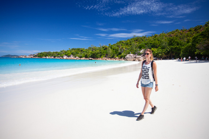 Walking on the beach on Praslin in the Seychelles