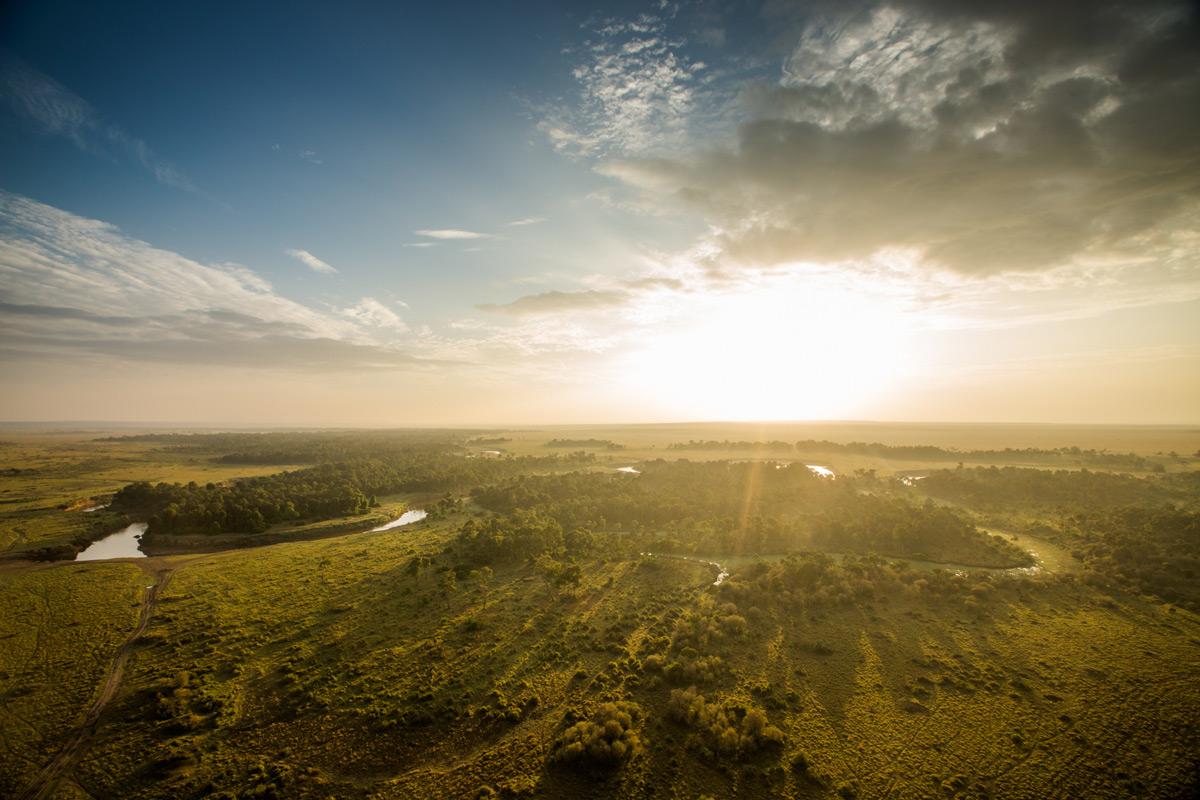 A view of the Mara River from a hot air balloon, Maasai Mara National Reserve, Kenya © Caleb Shepard