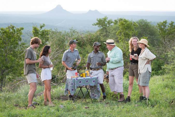 Guests enjoying sundowners in Balule