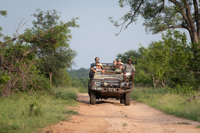 Themba with guide and guests on safari