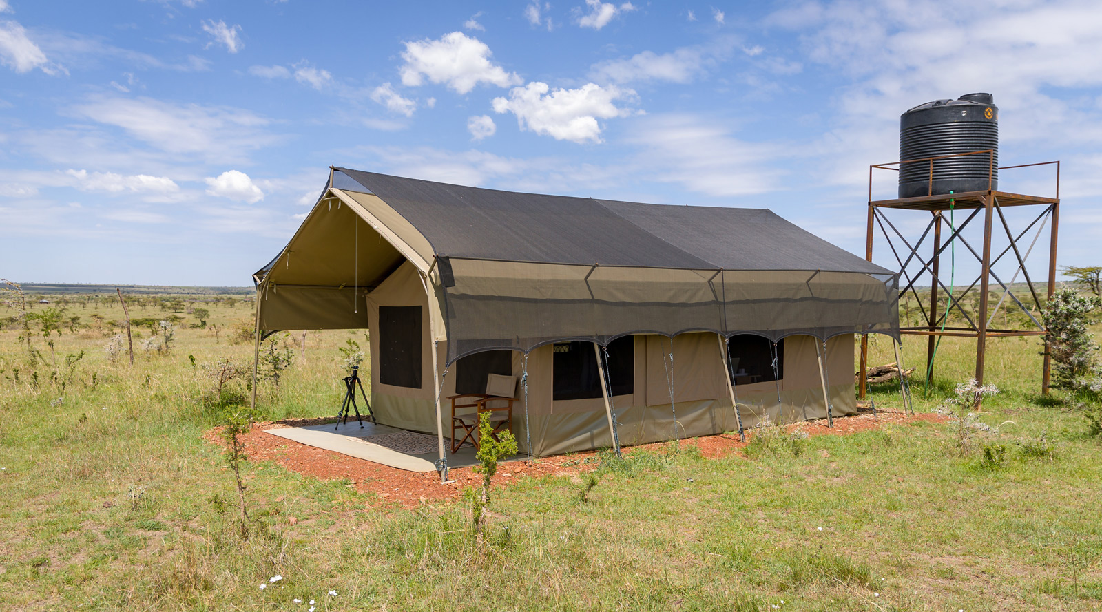 """Maasai Mara """"The camp was just perfect for my needs: a very large tent all to myself, a flushing toilet, a shower with hot and cold water, and a solar energy battery charger."""" ©Ruzdi Ekenheim"""