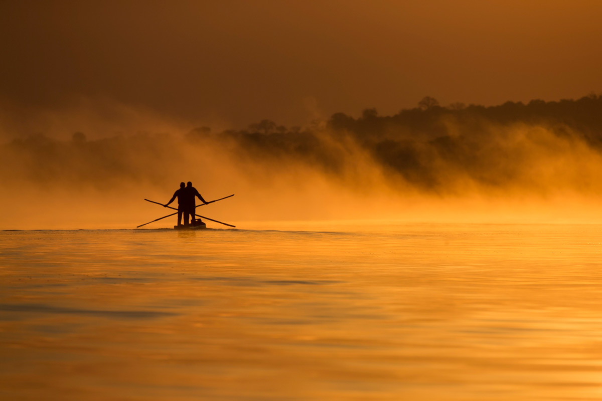 Fishermen at sunrise on the Chobe River, Chobe, Botswana © Johan Van Rensburg
