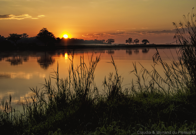 Sunrise over the Okavango River, Namibia