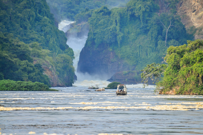 A boat approaches the famous Murchison Falls in Murchison Falls National Park