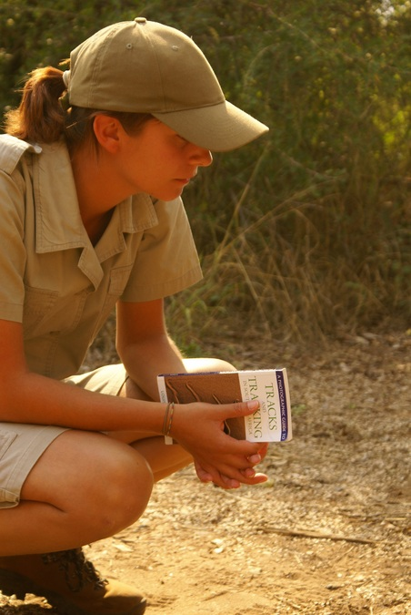 Female field guide with tracking book