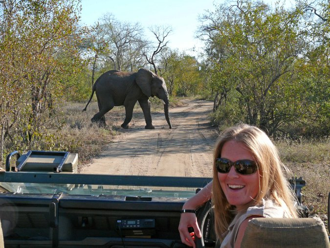 Female field guide with elephant in background