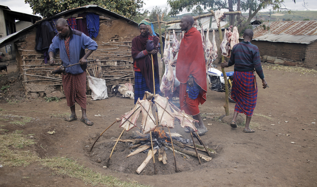 Mutton being cooked over open fire in Monduli Juu village in Tanzania
