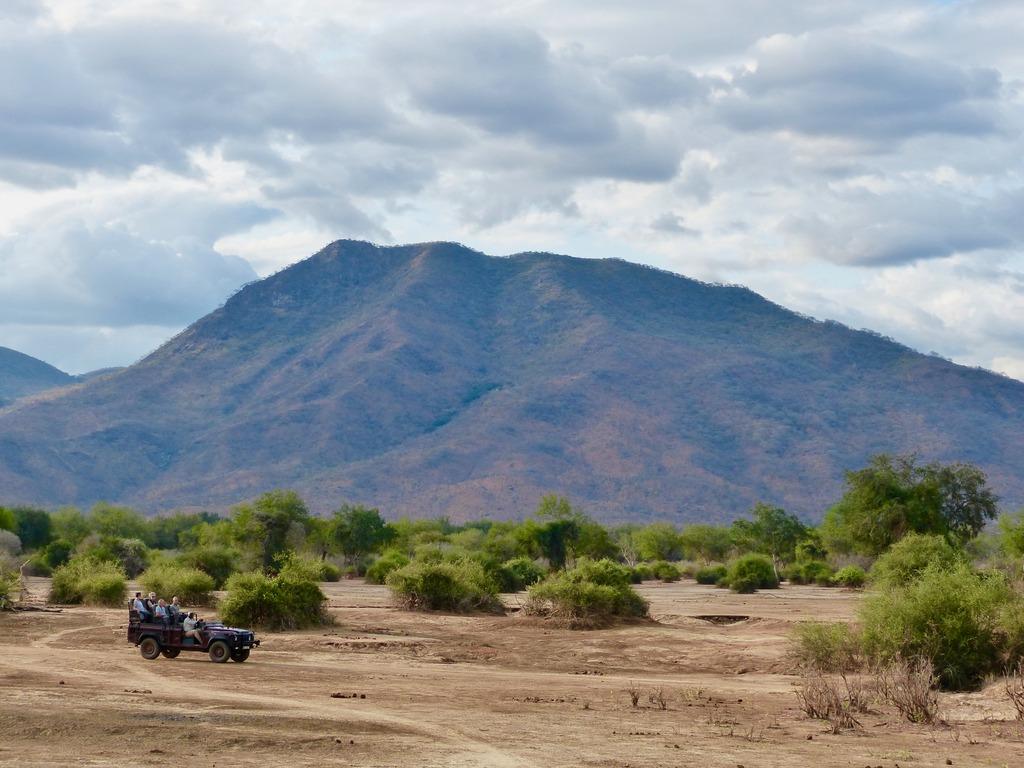 Safari vehicle with guests in Lower Zambezi National Park in Zambia