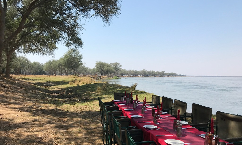 Table and chair for guests along the shore of Zambezi River in Zambia