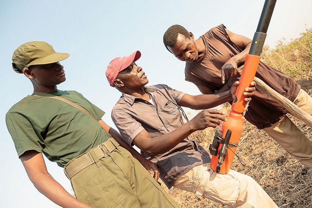 Three men inspecting the chilli blaster