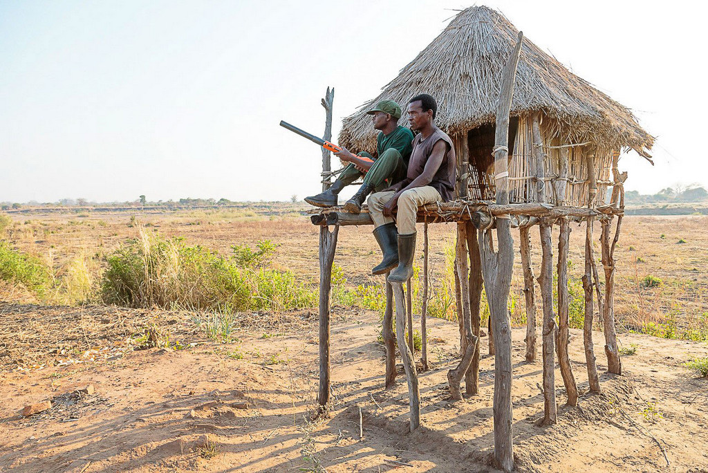 Two men on patrol near South Luangwa National Park, Zambia