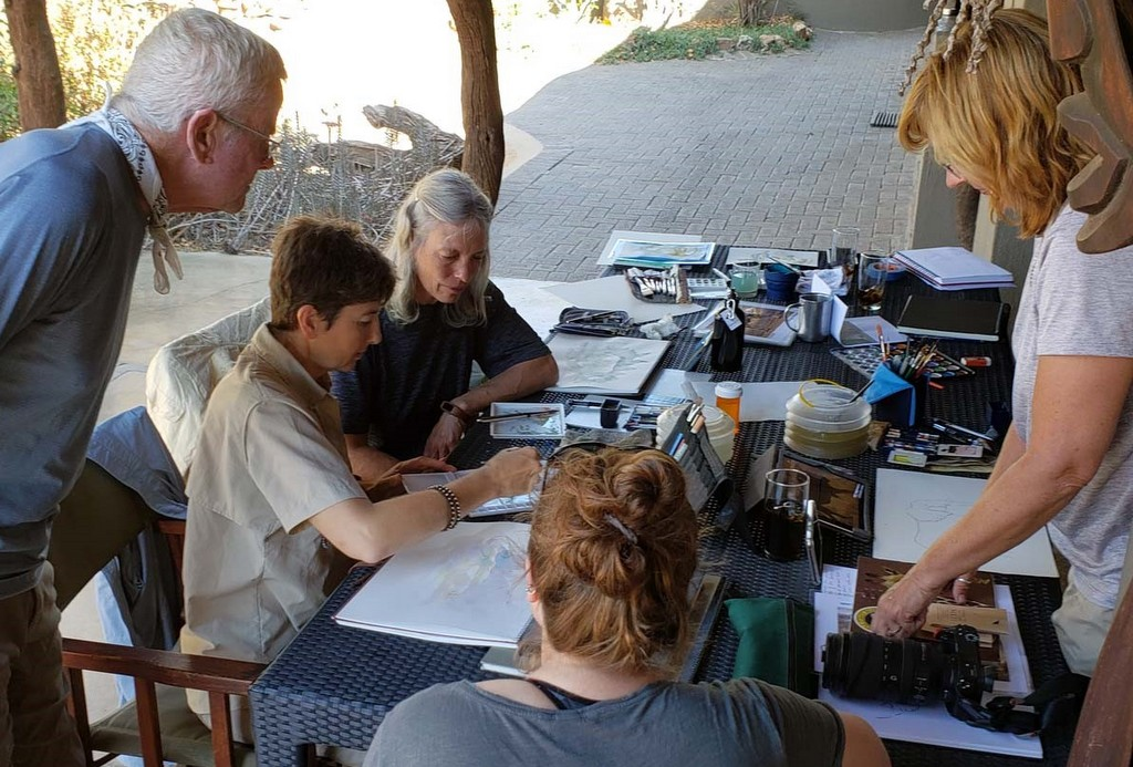 Artist looking at their work at a lodge in Greater Kruger, South Africa