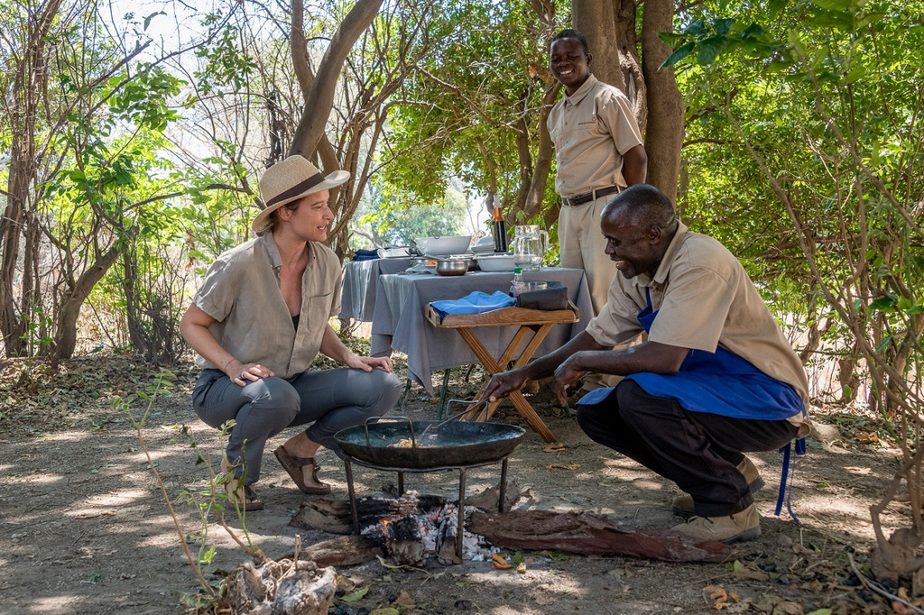 Guide preparing breakfast at camp in South Luangwa National Park in Zambia