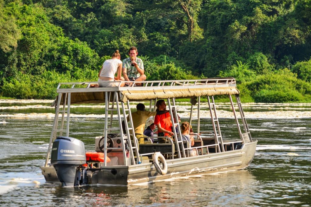 Boat safari with guests on River Nile in Murchison Falls in Uganda