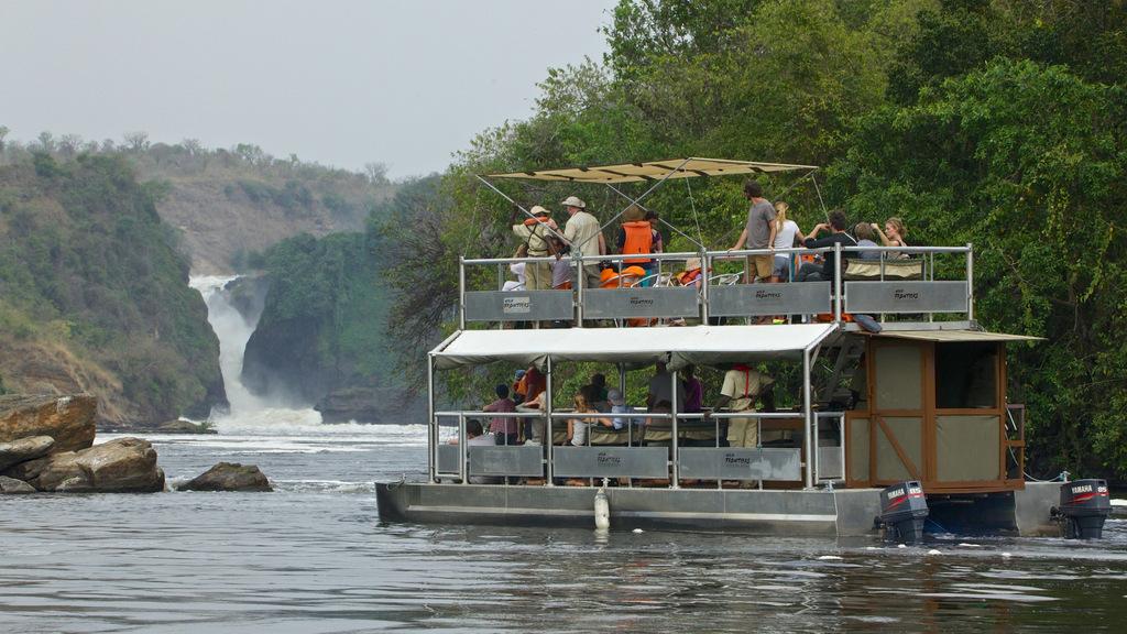 Guests on boat safari on River Nile in Murchison Falls in Uganda
