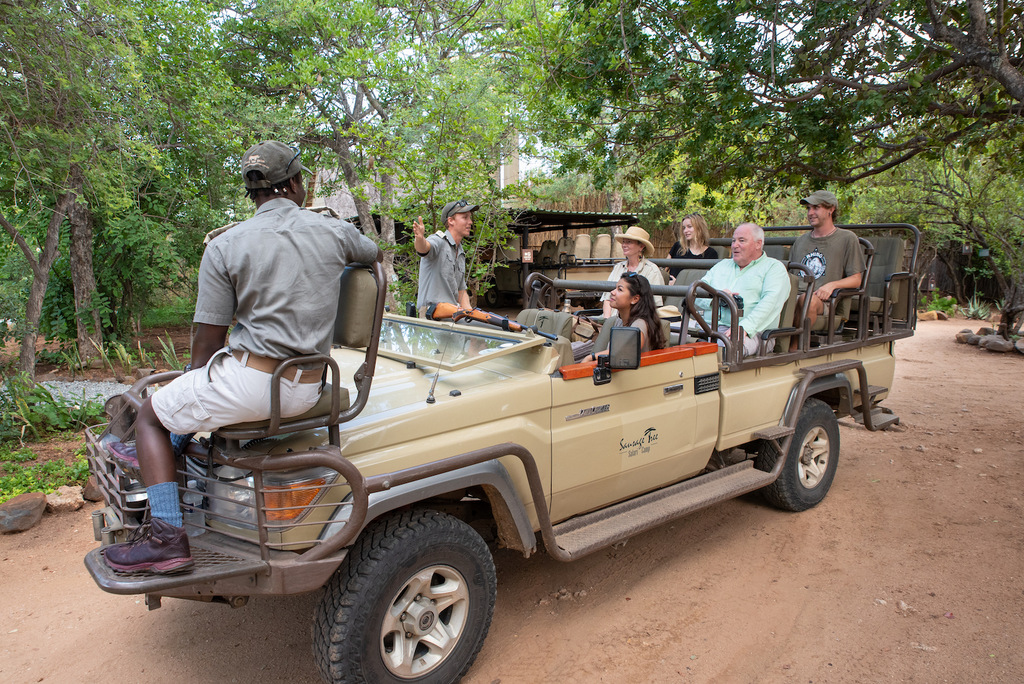 Guests with game ranger on vehicle at Sausage Tree Safari Lodge, Greater Kruger National Park, South Africa