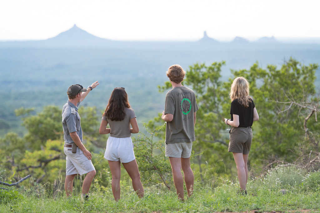 Guests with game ranger in Greater Kruger National Park, South Africa
