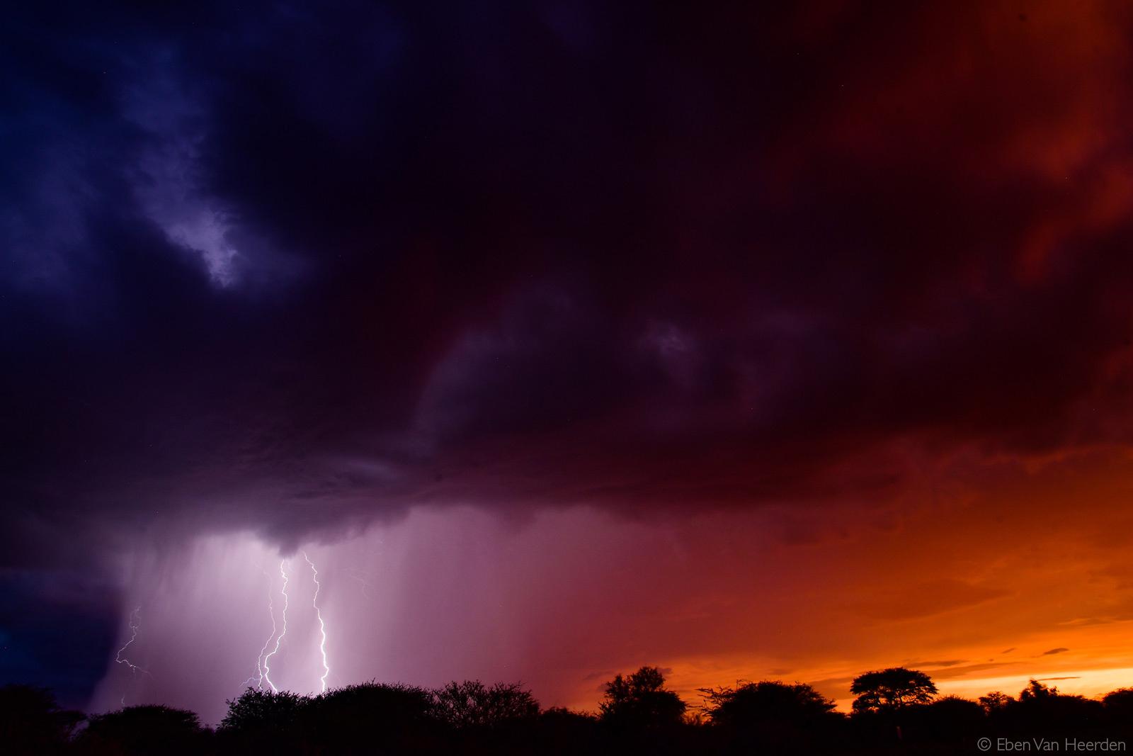 Lightning strikes as the sun sets. Kalahari Desert, Botswana © Eben Van Heerden
